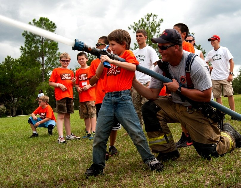 A camper tries his hand at using a firehose at Camp Corral's Camp Ocala in FL